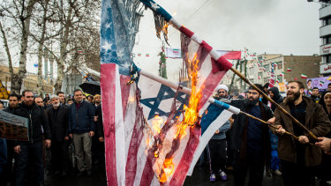 Iranians burn US and Israeli national flags during celebrations marking the 40th anniversary of the Islamic revolution in Tehran.