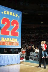 Fred Neal with his grandson in 2008, after his number was retired by the Globetrotters.
