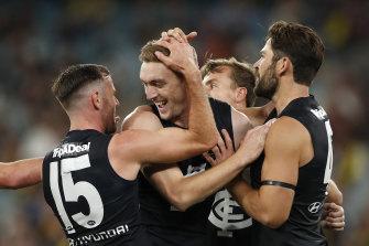 Oscar McDonald celebrates his first goal for Carlton.