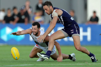Carlton's Darcy Lang dives for the ball under pressure from Fremantle recruit James Aish.