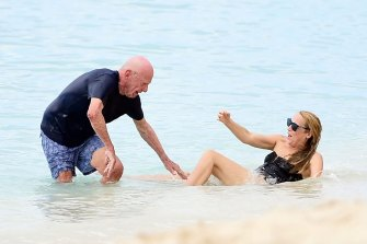 Oops: Media mogul Rupert Murdoch and Jerry Hall have a little trouble leaving the water in Barbados.