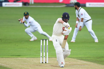 Asad Shafiq takes the catch to dismiss Rory Burns on a rain-shortened fourth day of the second Test in Southampton.