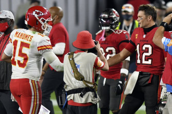Legendary quarterback Tom Brady (right) will come up against Patrick Mahomes (right).