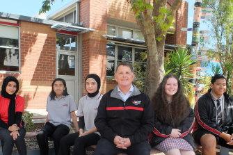 Hampton Park Secondary College students Fadak Jabbar, Vernon Santiago, Zahra Akhlaqee, principal Wayne Haworth, Paige Read, and Skyline Paileguto.
