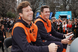 Toby Greene and Jeremy Cameron soaking up last year's grand final parade. Both have been appointed to the GWS Giants' new-look leadership group.