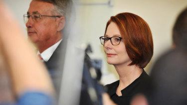 Wayne Swan with Julia Gillard after Kevin Rudd resumed the leadership in 2013.