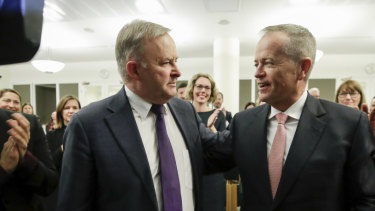 The new Labor leader Anthony Albanese  with former leader Bill Shorten at a caucus meeting on Thursday.