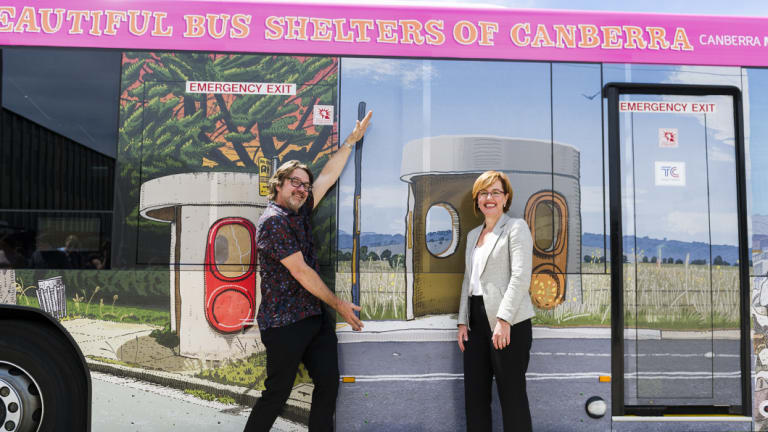 Canberra artist Trevor Dickinson and Transport Minister Meegan Fitzharris with the new bus wrapped in Dickinson's bus-stop artwork.