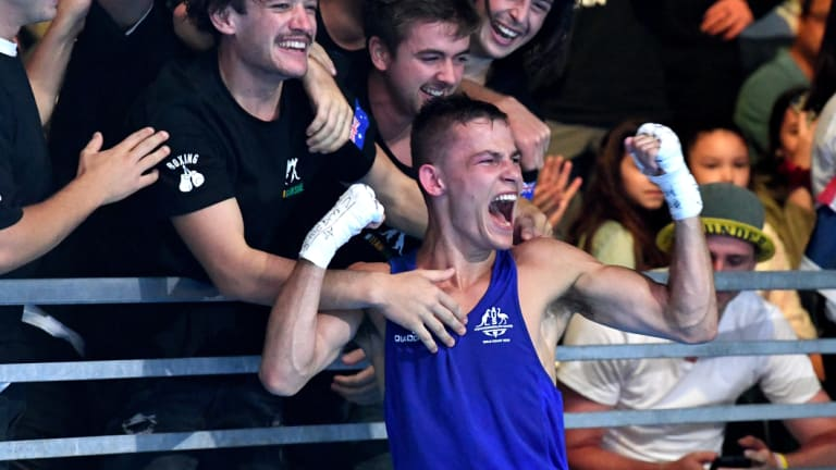 Harry Garside celebrates after defeating India's Manish Kaushik in the men's 60kg boxing final.