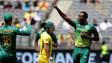 Tall order: Lungi Ngidi (right) of South Africa celebrates after dismissing Australian opener Aaron Finch.