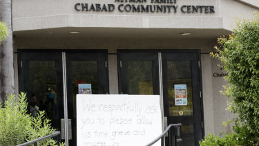 A sign asks for time to grieve at the Chabad of Poway synagogue.