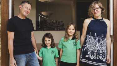 Canberra architect Robbie Gibson has invested into SolarShare, a community run solar farm. Mr Gibson is pictured with his wife Karin Gustavsson, and their children Nelly 6, and Freya 9.