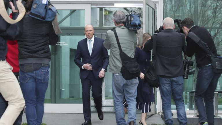 Peter Dutton on the way to a press conference on Thursday.