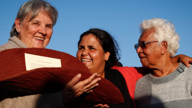 Pat Anderson with a piti holding the Uluru Statement from the Heart, with Sally Scales and Irene Davey, in May 2017.