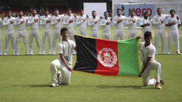 Afghanistan's players line up for the national anthem in their first ever Test. This week's win over Ireland was their second ever match.