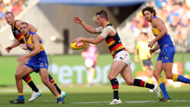 Dogged: Matt Crouch helped keep the Crows in the contest.