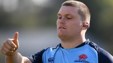 Listen up: Tom Robertson's ears get special attention.