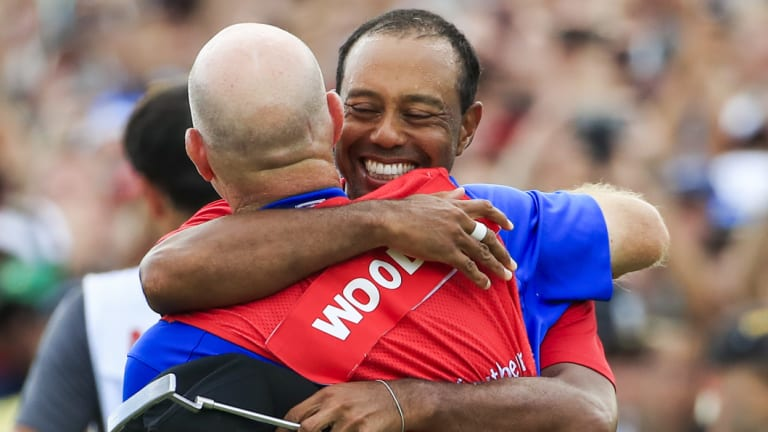 Drought over: Tiger Woods celebrates with caddie Joe LaCava after the Tour Championship golf tournament and the FedEx Cup final at Eastlake Golf Club in Atlanta, Georgia.