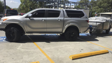 A ute with a trailer parked illegally across four disabled parking spaces earlier this month.