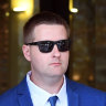 Senior Constable Andrew Bruce leaves court on Monday.