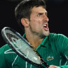 Wounded Federer in gallant loss to Djokovic