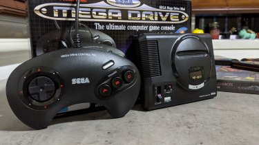 The system comes with two full-sized replicas of the original three-button controller.