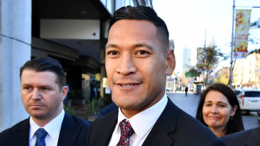 Israel Folau arrives for a conciliation hearing at the Fair Work Commission in Sydney.