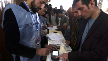 Local residents use their fingerprints to register to vote in the parliamentary elections in Kabul, Afghanistan in October.