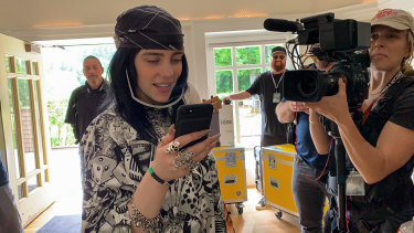 Billie Eilish filming her new music documentary Billie Eilish: The World's a Little Blurry, out Friday on Apple TV+.