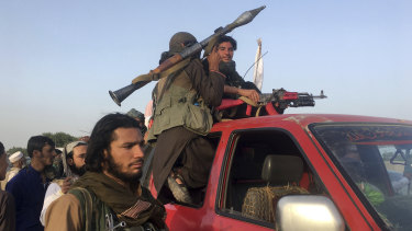 Taliban fighters ride in their vehicle in Surkhroad district of Nangarhar province, east of Kabul, Afghanistan, on Saturday.