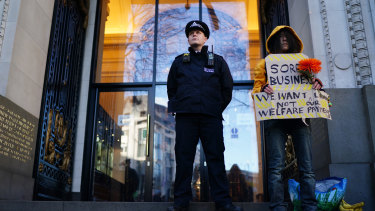 A police officer stands guard outside Australia House on The Strand.