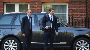 Mark Carney, governor of the Bank of England, left, departs from for a special Brexit 'No Deal' meeting of cabinet ministers at number 10 Downing Street in London on Thursday, September 13.
