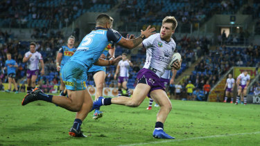 Storming ahead: Cameron Munster in action against the Titans.