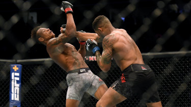 Max Griffin punches Alex Oliveira.