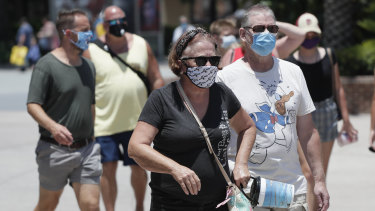 People wearing face masks at a shopping centre in Florida, where coronavirus cases have spiked.