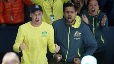 John Millman and Nick Kyrgios cheer on Alex De Minaur against David Goffin of Belgium at the Davis Cup.