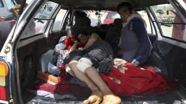 An injured man is transported on the Ghazni highway, in Maidan Shar, west of Kabul, Afghanistan.