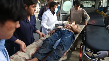 A male is treated after a classroom of students was hit in the Shiite neighbourhood of Dasht-i Barcha.