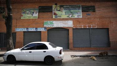 "A car is parked in front of ""Los Cotorros"" club at the neighbourhood of El Paraiso, in Caracas, Venezuela, on Saturday."