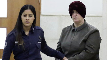 Malka Leifer, right, is brought to a courtroom in Jerusalem in 2018.