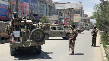 Afghan security personnel arrive at the site where the gunmen attacked.