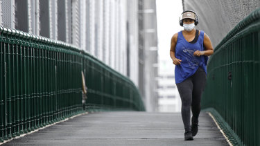 A jogger on the Story Bridge wearing a mask on Saturday, January 9.