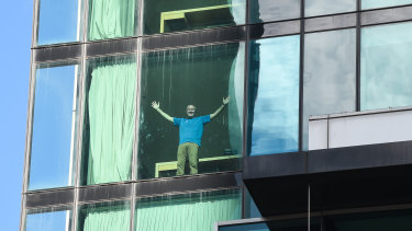 Quarantine guest Patrick Enright celebrates 'leaving day' after two weeks in a quarantine hotel.