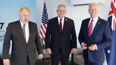 Britain's Prime Minister Boris Johnson (left) with Prime Minister Scott Morrison and US President Joe Biden at the G7 summit.