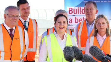 Queensland Premier Annastacia Palaszczuk (centre) talks with Australian Prime Minister Scott Morrison (left) and Minister for Agriculture Bridget McKenzie (right) at a construction site in the suburb of Rochedale, in Brisbane where details of new infrastructure funding was announced on Wednesday.