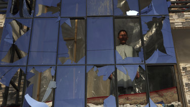 An Afghan boy looks out from a broken window after a bomb explosion in Kabul in February.