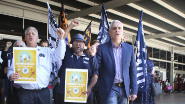 Michael Kaine leading a rally of airport employees protesting against working conditions at Sydney Airport last year.