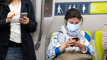 A commuter wears a protective mask in San Francisco.
