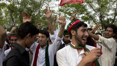 Supporters of politician Imran Khan dance to celebrate his victory.