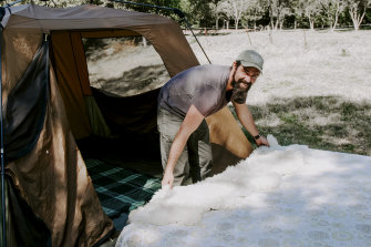 Ben Gray sorts out the tent.